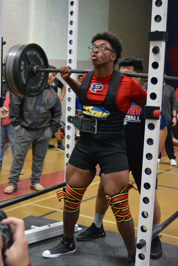 Plainview Bulldog D'Shae Casias prepares to complete his squat during the Plainview Invitational on Saturday at Coronado Middle School in Plainview. Casias placed first at 220. Photo: Alexis Cubit/Plainview Herald