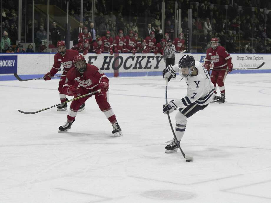 Yale's Joe Snively lets go a wrist shot which hit the post midway thru the first period. Photo: Steven Musco / Yale Athletics / muscosportsphotos.com