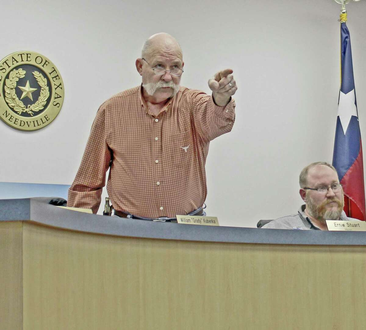 """Tempers flared at a recent Needville City Council meeting during discussions over a lawsuit recently filed against the city temporarily blocking plans to demolish the city's historic water tower. Mayor Stuart stood and yelled for police officers to escort a woman from the meeting after she spoke out from the audience. """"You people think I am playing up here?"""" Stuart said, shaking his finger at the standing-room only crowd. A trial is scheduled Oct. 9 to decide the fate of the water tower."""