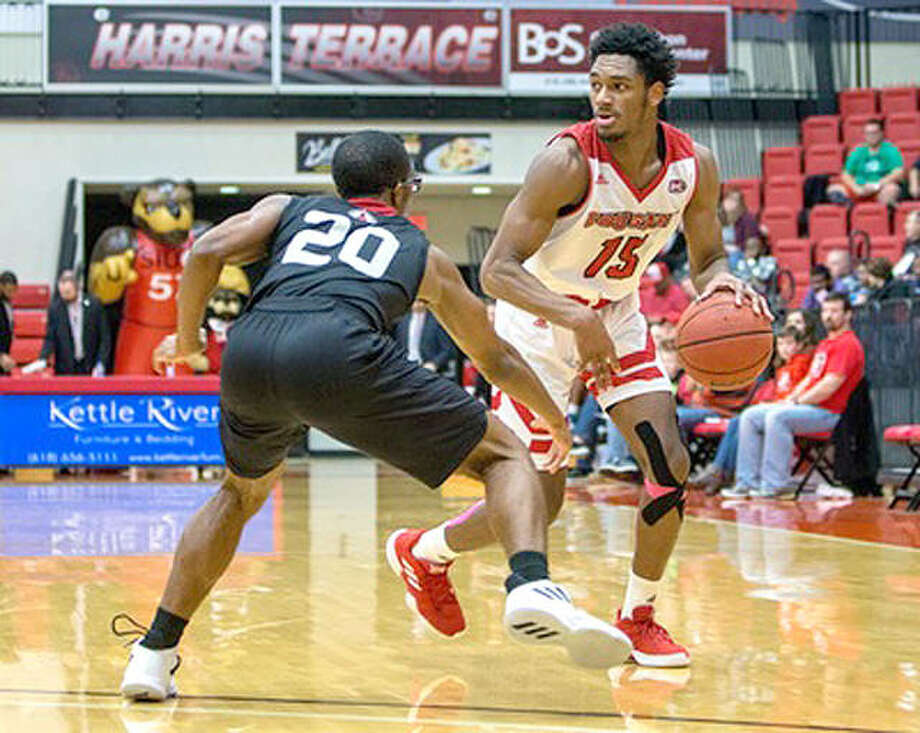 SIUE's David McFarland (15) scored 10 points in the Cougars loss Saturday at Jacksonville State. He is shown in action earlier this season. Photo: SIUE Athletics