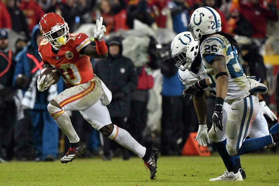 Kansas City Chiefs wide receiver Tyreek Hill (10) gestures as he runs past Indianapolis Colts safety Clayton Geathers (26) and linebacker Anthony Walker during the second half of an NFL divisional football playoff game in Kansas City, Mo., Saturday, Jan. 12, 2019. (AP Photo/Ed Zurga) Photo: Ed Zurga / Copyright 2019 The Associated Press. All rights reserved