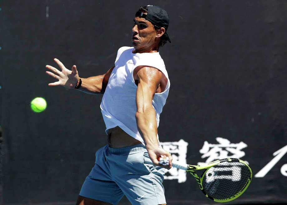 Spain's Rafael Nadal prepares to hit a forehand return during a practice session at the Australian Open tennis championships in Melbourne, Australia, Sunday, Jan. 13, 2019. (AP Photo/Mark Schiefelbein) Photo: Mark Schiefelbein / Copyright 2018 The Associated Press. All rights reserved