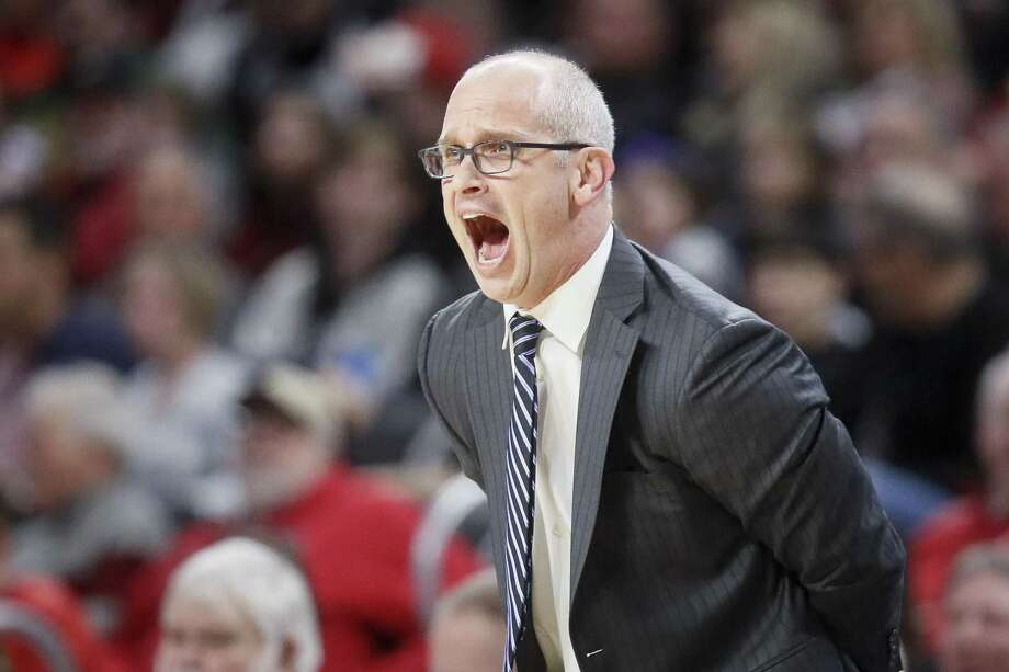 Connecticut head coach Dan Hurley directs his players from the bench against Cincinnati on Saturday in Cincinnati. Photo: John Minchillo / Associated Press / Copyright 2019 The Associated Press. All rights reserved.