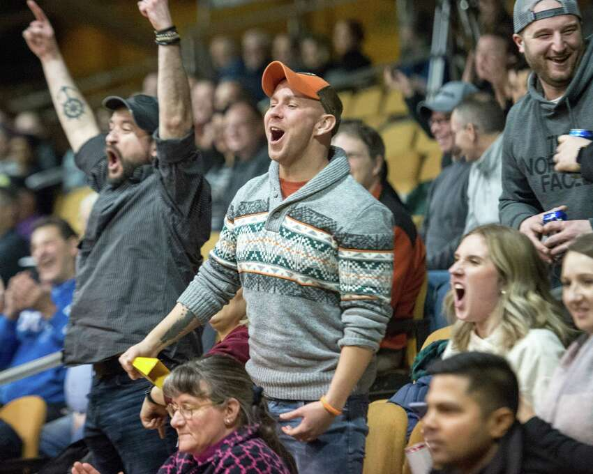 Fans cheer on the Albany Patroons during the team's home opener against the New York Court Kings on Saturday Jan. 12, at Washinton Avenue Armory. (Jim Franco / Special to the Times Union)