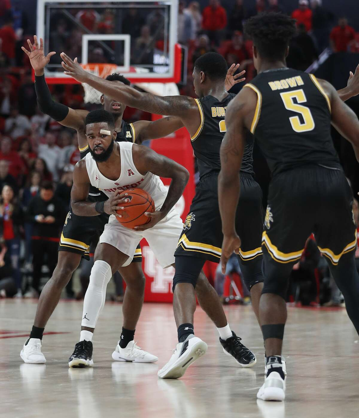Houston Cougars guard Corey Davis Jr. (5) with a bandage on his head looks to pass the ball during the second half of an NCAA Men's basketball game at Fertitta Center, Saturday, Jan. 12, 2019, in Houston. Houston won the game against Wichita State Shockers 79-70.