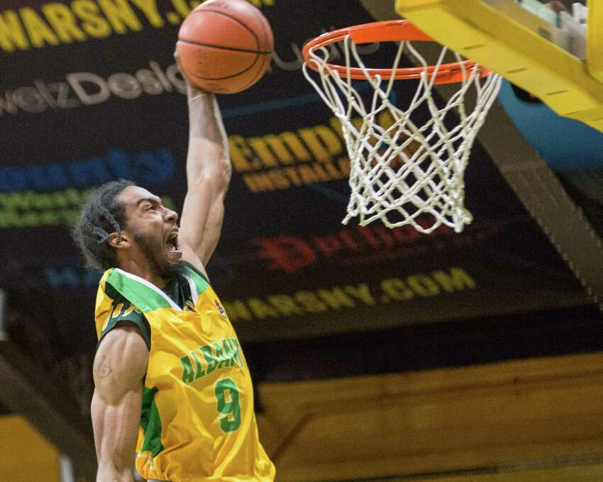 Albany guard Sajae Pryor throws down a dunk during the Albany Patroons' home opener against the New York Court Kings on Saturday, Jan. 12, at Washington Avenue Armory. (Jim Franco / Special to the Times Union)