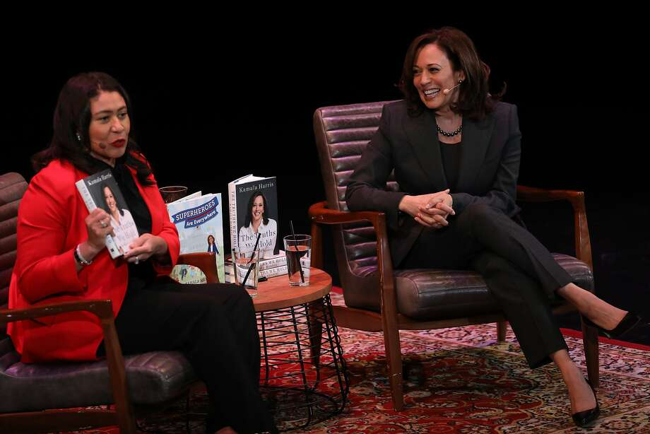 "San Francisco Mayor London Breed holds up Kamala Harris' new memoir, ""The Truths We Hold,"" while interviewing the senator onstage at the Curran theater in San Francisco. Photo: Photos By Yalonda M. James / The Chronicle"
