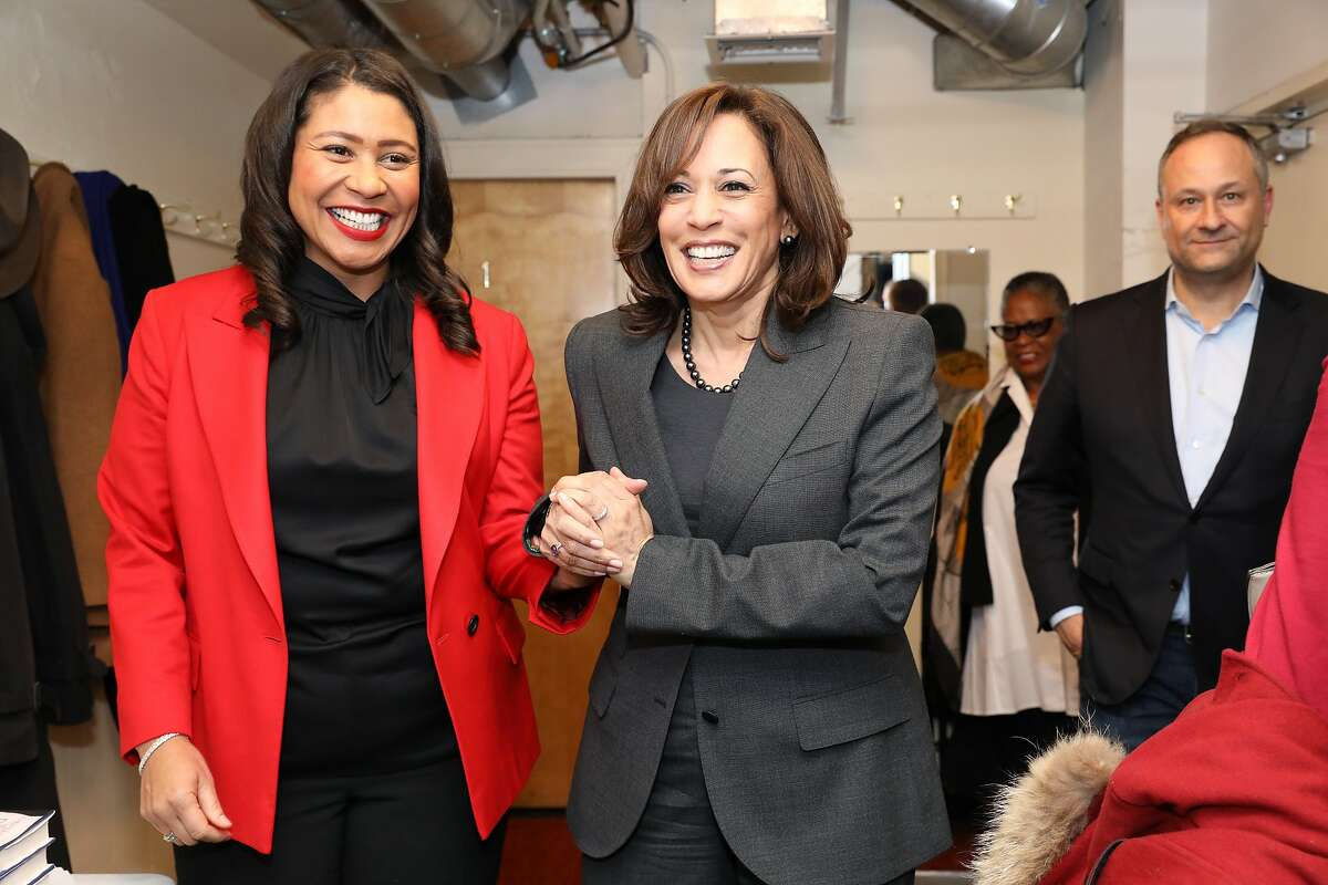 Senator Kamala Harris (center) holds hands with San Francisco Mayor London Breed at the Curran in San Francisco, Calif., on Saturday, January 12, 2019. Harris spoke on stage about her new memoir.