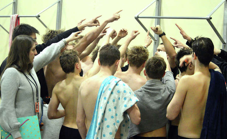 The Edwardsville boys' swim team gathers after Thursday's triangular meet against Chatham Glenwood and O'Fallon at Chuck Fruit Aquatic Center. Photo: Scott Marion/Intelligencer