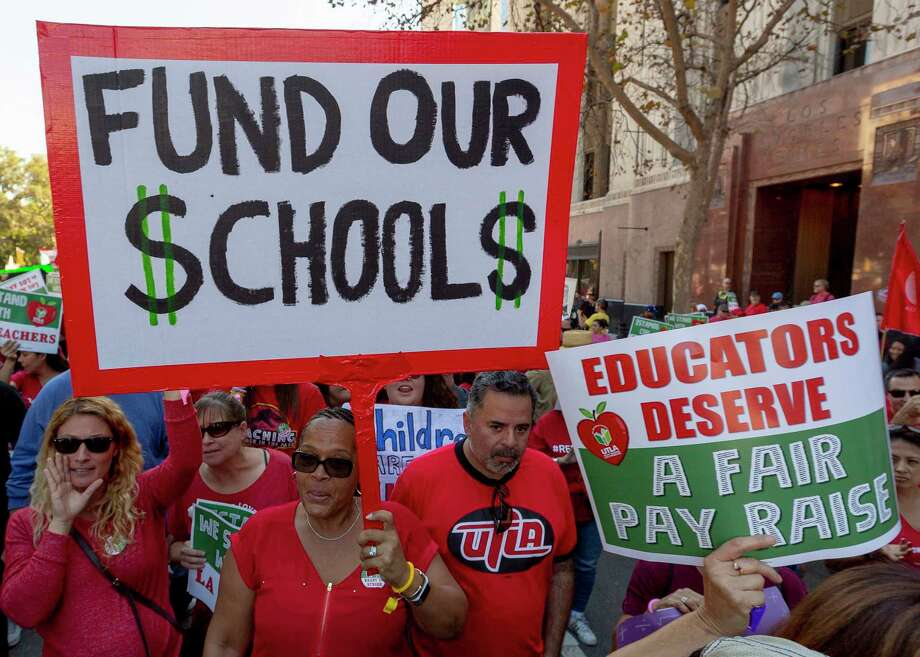 FILE - In this Dec. 15, 2018, file photo, thousands of teachers marched and rallied in downtown Los Angeles.  Strike or no strike, after a deal is ultimately reached on a contract for Los Angeles teachers, the school district will still be on a collision course with deficit spending because of pensions and other financial obligations. .(AP Photo/Damian Dovarganes, File) Photo: Damian Dovarganes / Copyright 2018 The Associated Press. All rights reserved.