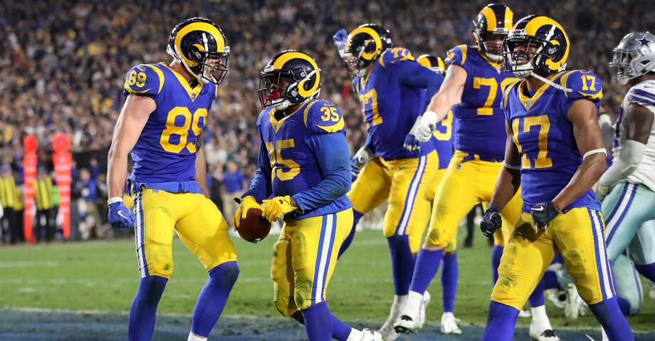 LOS ANGELES, CA - JANUARY 12:  C.J. Anderson #35 of the Los Angeles Rams celebrates with teammates after a 1 yard touchdown run in the fourth quarter against the Dallas Cowboys in the NFC Divisional Playoff game at Los Angeles Memorial Coliseum on January 12, 2019 in Los Angeles, California.  (Photo by Sean M. Haffey/Getty Images) Photo: Sean M. Haffey/Getty Images