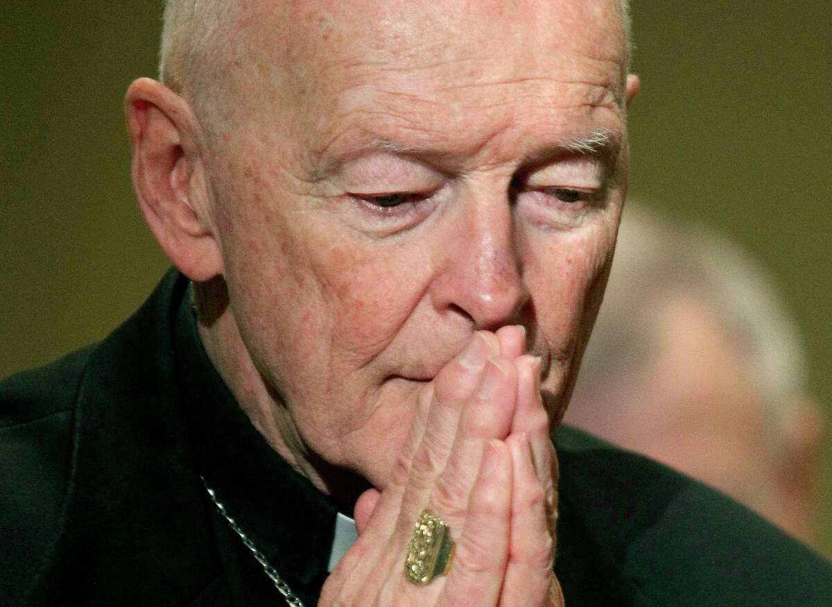 FILE - In this Nov. 14, 2011, file photo, then Cardinal Theodore McCarrick prays during the United States Conference of Catholic Bishops' annual fall assembly in Baltimore. A lawyer says the key accuser in the sex abuse case against ex-Cardinal Theodore McCarrick has met with New York City prosecutors, evidence that the scandal that has convulsed the papacy is now part of the broader U.S. law enforcement investigation into sex abuse and cover-up in the Catholic Church. (AP Photo/Patrick Semansky, File)