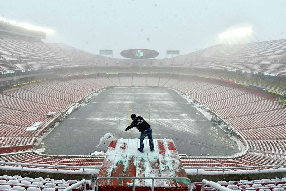 Kyle Haraugh, of NFL Films, clears snow from a camera location at Arrowhead Stadium before an NFL divisional football playoff game between the Kansas City Chiefs and the Indianapolis Colts, in Kansas City, Mo., Saturday, Jan. 12, 2019. (AP Photo/Ed Zurga) Photo: Ed Zurga / Copyright 2019 The Associated Press. All rights reserved
