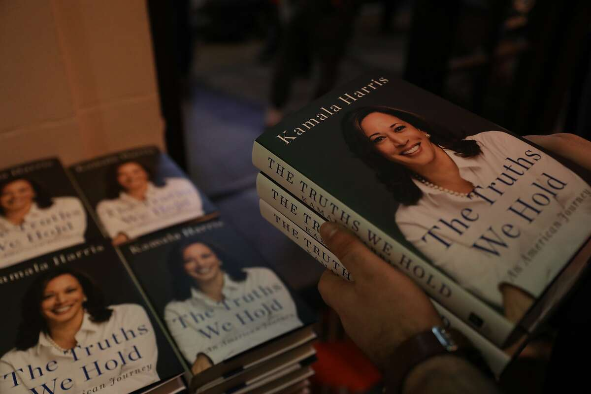 """Zack Dubuc, operations and logistics manager for Book Passage, holds a copy of Senator Kamala Harris' new memoir """"The Truths We Hold: An American Journey,"""" at the Curran in San Francisco, Calif., on Saturday, January 12, 2019. Harris spoke on stage about her new memoir."""