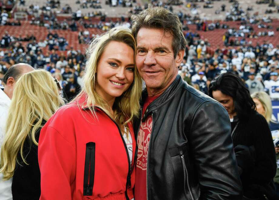 PHOTOS: Celebrities at the Rams-Cowboys playoff game on Saturday night LOS ANGELES, CA - JANUARY 12: Dennis Quaid and girlfriend Santa Auzina pose for photos before the Los Angeles Rams NFC Divisional Round playoff game against the Dallas Cowboys at Los Angeles Memorial Coliseum on January 12, 2019 in Los Angeles, California. Browse through the photos above for a look at some of the celebrities on hand to watch the Rams beat the Cowboys on Saturday night ... Photo: Kevork Djansezian, Getty Images / 2019 Getty Images