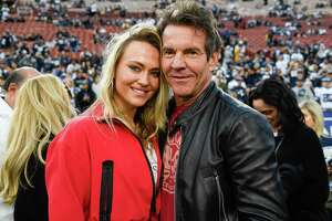 LOS ANGELES, CA - JANUARY 12: Dennis Quaid and girlfriend Santa Auzina pose for photos before the Los Angeles Rams NFC Divisional Round playoff game against the Dallas Cowboys at Los Angeles Memorial Coliseum on January 12, 2019 in Los Angeles, California.