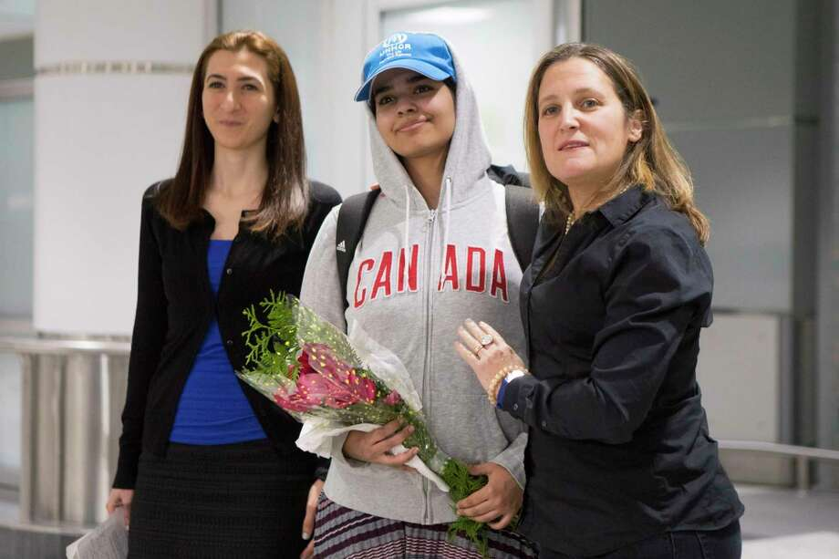 Rahaf Mohammed Alqunun, 18, center, stands with Canadian Minister of Foreign Affairs Chrystia Freeland, right, as she arrives at Toronto Pearson International Airport, on Saturday, Jan.12, 2019.  The Saudi teen fled her family while visiting Kuwait and flew to Bangkok, where she barricaded herself in an airport hotel and launched a Twitter campaign that drew global attention to her case. Prime Minister Justin Trudeau announced his government would accept her as a refugee.  (Chris Young/The Canadian Press via AP) Photo: Chris Young / The Canadian Press
