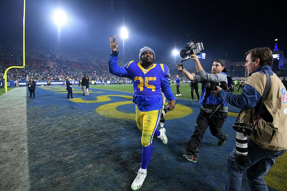 LOS ANGELES, CA - JANUARY 12: C.J. Anderson #35 of the Los Angeles Rams runs off the field after defeating the Dallas Cowboys in the NFC Divisional Playoff game at Los Angeles Memorial Coliseum on January 12, 2019 in Los Angeles, California. The Rams defeated the Cowboys 30-22. (Photo by Harry How/Getty Images)