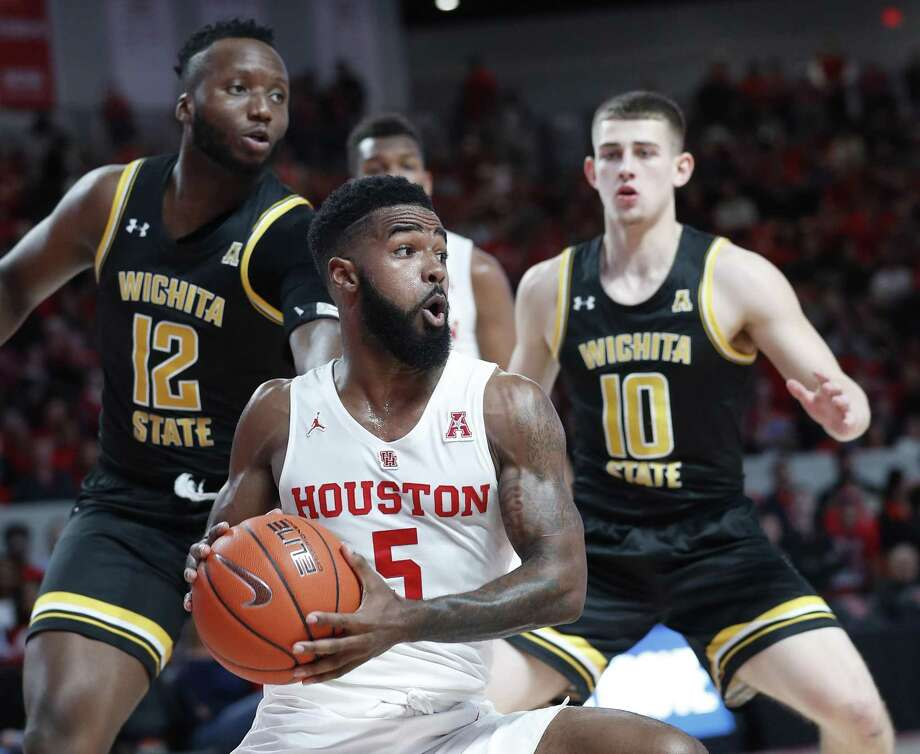 PHOTOS: Houston Cougars in Super Bowl Houston Cougars guard Corey Davis Jr. (5) spins around as he fought off Wichita State Shockers forward Morris Udeze (12) and guard Erik Stevenson (10) during the first half of an NCAA Men's basketball game at Fertitta Center, Saturday, Jan. 12, 2019, in Houston. >>>See the list of Cougars who have played or coached in the Super Bowl ... Photo: Karen Warren, Houston Chronicle / Staff Photographer / © 2019 Houston Chronicle