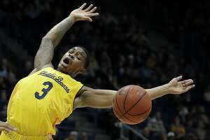 California's Paris Austin loses the ball during the first half of the team's NCAA college basketball game against Arizona on Saturday, Jan. 12, 2019, in Berkeley, Calif. (AP Photo/Ben Margot)