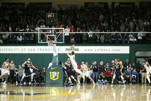 San Francisco Dons guard Frankie Ferrari (2) makes the shot in the last few second of the first half in an NCAA basketball game against the Gonzaga Bulldogs at Memorial Gym on Saturday, Jan. 12, 2019, in San Francisco, Calif.