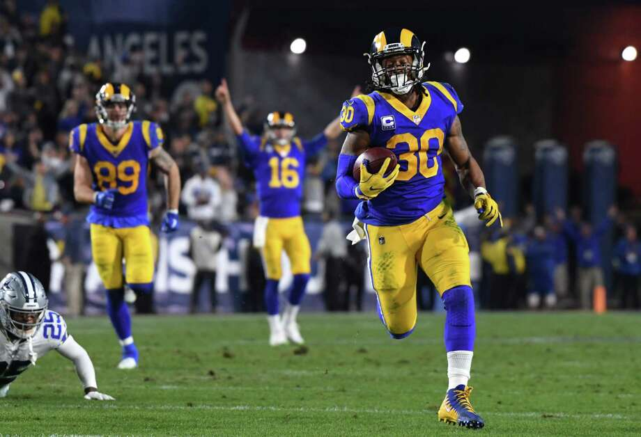 LOS ANGELES, CA - JANUARY 12: Todd Gurley #30 of the Los Angeles Rams runs for a 35 yard touchdown in the second quarter against the Dallas Cowboys in the NFC Divisional Playoff game at Los Angeles Memorial Coliseum on January 12, 2019 in Los Angeles, California.  (Photo by Harry How/Getty Images) Photo: Harry How / 2019 Getty Images