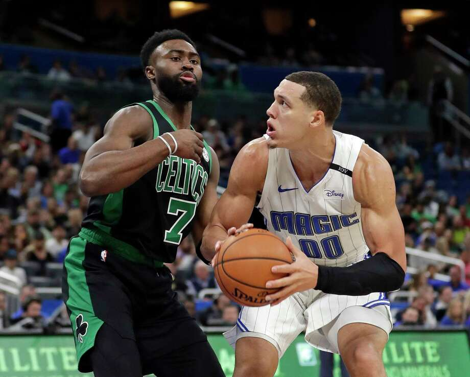 Orlando Magic's Aaron Gordon (00) looks for a shot in front of Boston Celtics' Jaylen Brown (7) during the first half of an NBA basketball game, Saturday, Jan. 12, 2019, in Orlando, Fla. (AP Photo/John Raoux) Photo: John Raoux / Copyright 2019 The Associated Press. All rights reserved