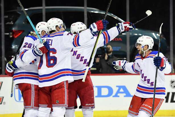 NEW YORK, NEW YORK - JANUARY 12: Tony DeAngelo #77 of the New York Rangers reacts with his teammates after the Rangers score a goal during the third period of the game against the New York Islanders at Barclays Center on January 12, 2019 in the Brooklyn borough of New York City. (Photo by Sarah Stier/Getty Images)