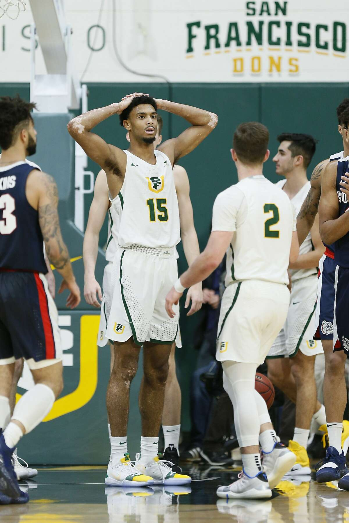 San Francisco Dons forward Nate Renfro (15) reacts after a foul is called against the Dons in the second half of an NCAA basketball game against the Gonzaga Bulldogs at Memorial Gym on Saturday, Jan. 12, 2019, in San Francisco, Calif.