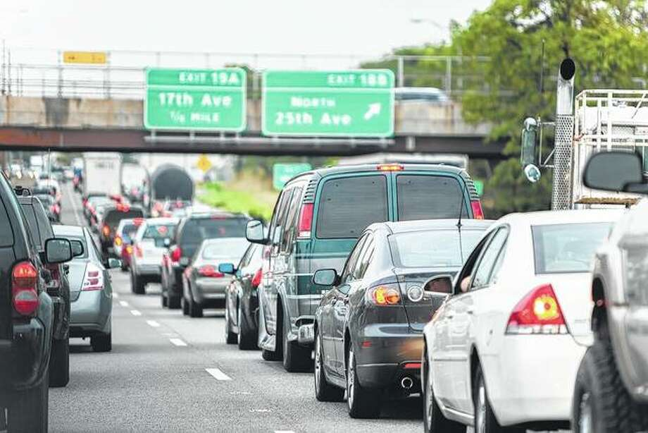 Brake lights are engaged as cars stop on an interstate near Chicago. A law approved two years ago that restricts the use of the left lane on highways will be more strictly enforced starting this year. Photo: Getty Images