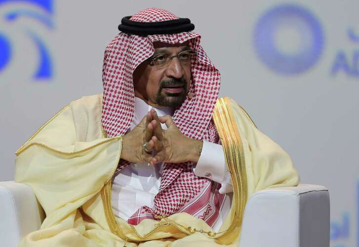 """FILE - In this Nov.12, 2018 file photo, Khalid Al-Falih, Saudi Energy and Oil Minister, speaks at the Abu Dhabi International Exhibition & Conference, in Abu Dhabi, United Arab Emirates. Al-Falih said Sunday, Jan. 13, 2019, at the Atlantic Council's Global Energy Forum in Abu Dhabi that he's not happy with the """"range of volatility"""" seen over the past two to three years. Cautious not to set a price target or range for oil, he explained there are consequences when energy prices dip too low or rise too high."""