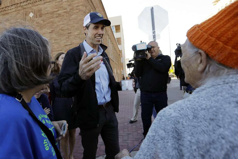 Beto O'Rourke greets voters at the polls in El Paso, Texas, in November. He lost his bid to unseat Republican Sen. Ted Cruz. Photo: Eric Gay / Associated Press 2018