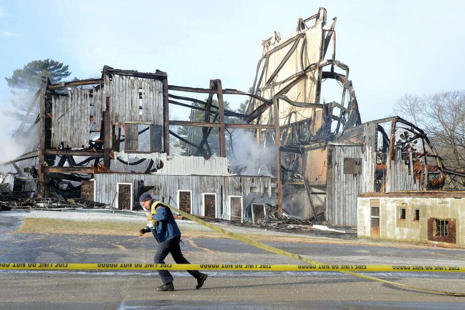 The Shakespeare Theater, in Stratford burned to the ground early Sunday morning. The theater opened in 1955 as the American Shakespeare Festival Theatre, the building had stood vacant for many years. Photo: Ned Gerard / Hearst Connecticut Media / Connecticut Post