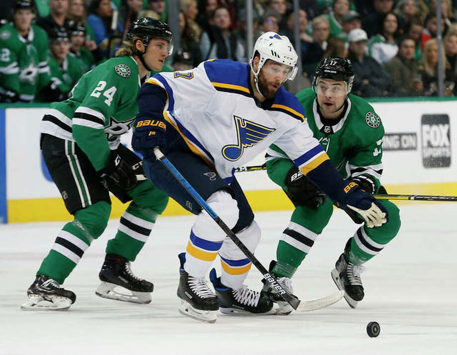 The Blues' Pat Maroon (middle) tries to get the puck past the Stars' Roope Hintz (24) and Devin Shore during the first period Saturday night in Dallas. Photo: Associated Press