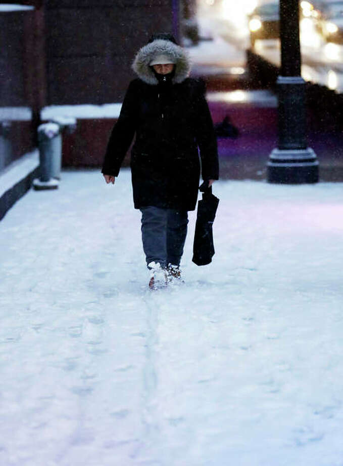 A man walks on a sidewalk in downtown Chicago, Saturday, Jan. 12, 2019. A winter weather advisory is in effect until 3 a.m. Sunday and covers northern Illinois and Northwest Indiana including Lee, DeKalb, Kane, DuPage and Cook counties. Photo: AP Photo/Nam Y. Huh
