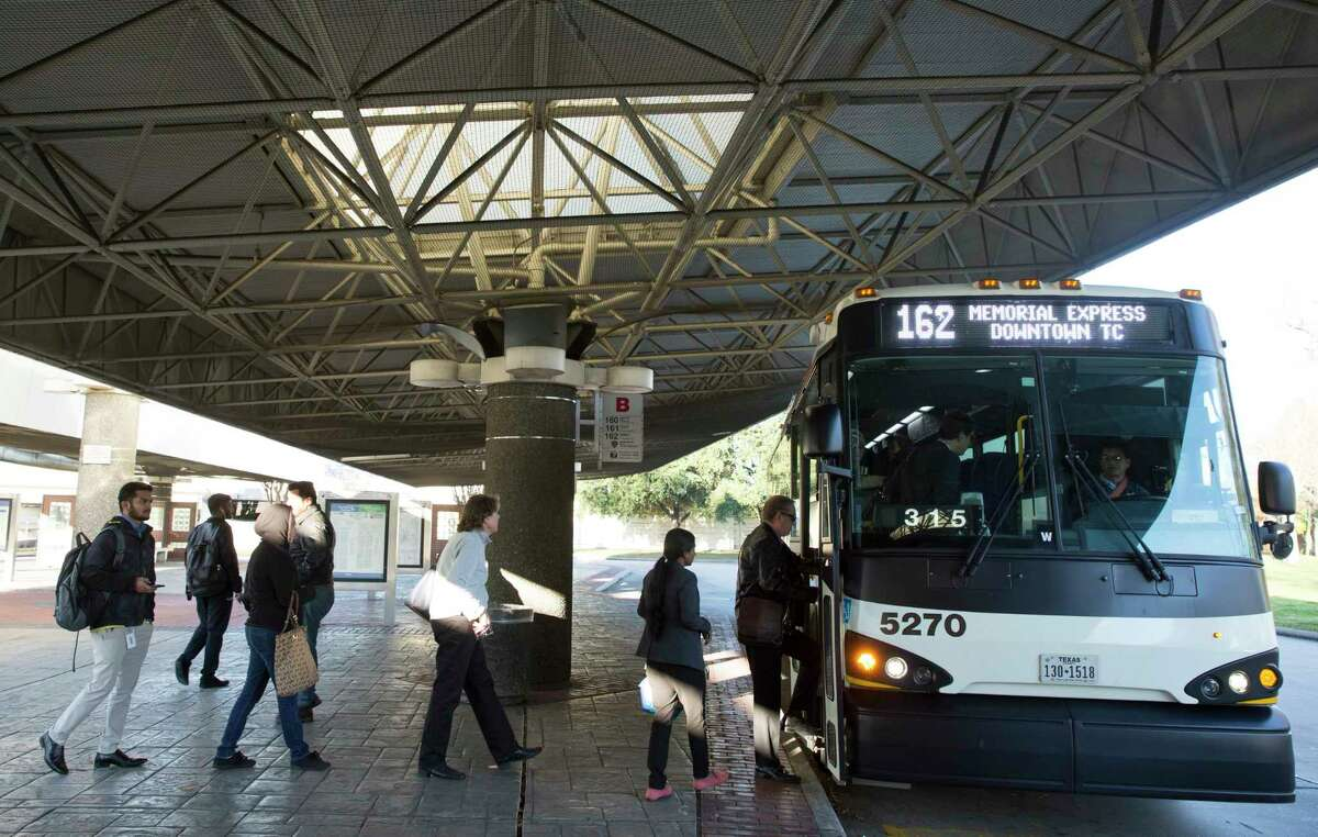 Passengers get on a Metropolitan Transit Authority Route 162 bus at the Northwest Transit Center on Jan. 10.