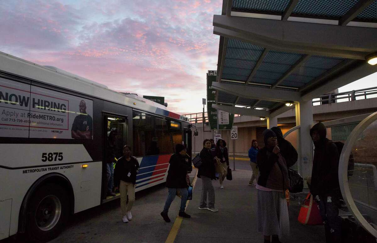 Passengers exit a Metropolitan Transit Authority bus at William P. Hobby Airport on Jan. 10. Metro is interested in extending rail lines to Hobby Airport.
