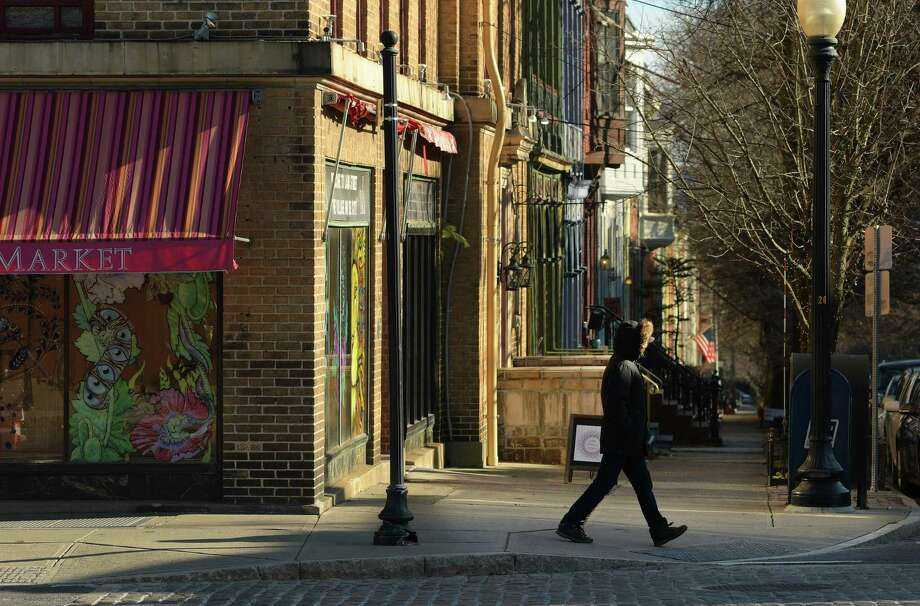 A man makes his way in the cold along a deserted section of Lark Street on Sunday, Jan. 13, 2019, in Albany, N.Y.   (Paul Buckowski/Times Union) Photo: Paul Buckowski, Albany Times Union / (Paul Buckowski/Times Union)