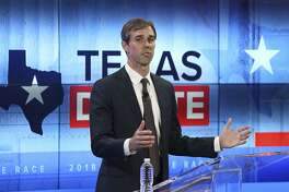FILE - In this Oct. 16, 2018, file photo, Rep. Beto O'Rourke, D-Texas, takes part in a debate with Sen. Ted Cruz, R-Texas, in San Antonio. O'Rourke barged into last year's Texas Senate race almost laughably early in March 2017. Now, as the onetime punk rocker mulls a much-hyped White House bid for 2020, he's doing anything he can to stay in the spotlight without formally starting a campaign. (Tom Reel/San Antonio Express-News via AP, Pool)