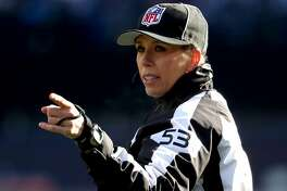 FOXBOROUGH, MASSACHUSETTS - JANUARY 13: NFL Down Judge Sarah Thomas signals a call in the AFC Divisional Playoff Game between the New England Patriots and the Los Angeles Chargers at Gillette Stadium on January 13, 2019 in Foxborough, Massachusetts. (Photo by Al Bello/Getty Images)