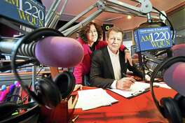 """Pam Landry, WQUN-AM operations manager with radio personality Brian Smith, formerly of WPLR's """"Smith & Barber"""" show, at the WQUN studios in Hamden in 2017."""