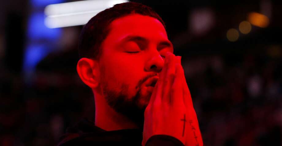 PHOTOS: Rockets game-by-game Houston Rockets guard Austin Rivers prays by himself during the opening ceremony of the NBA game against the Cleveland Cavaliers at Toyota Center on Friday, Jan. 11, 2019, in Houston. Browse through the photos to see how the Rockets have fared in each game this season. Photo: Yi-Chin Lee/Staff Photographer