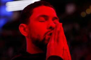 Houston Rockets guard Austin Rivers prays by himself during the opening ceremony of the NBA game against the Cleveland Cavaliers at Toyota Center on Friday, Jan. 11, 2019, in Houston.