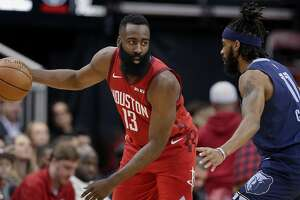 Houston Rockets guard James Harden (13) waits to progress a play as Memphis Grizzlies guard Mike Conley (11) defends during the first half of an NBA basketball game Monday, Dec. 31, 2018, in Houston. (AP Photo/Michael Wyke)