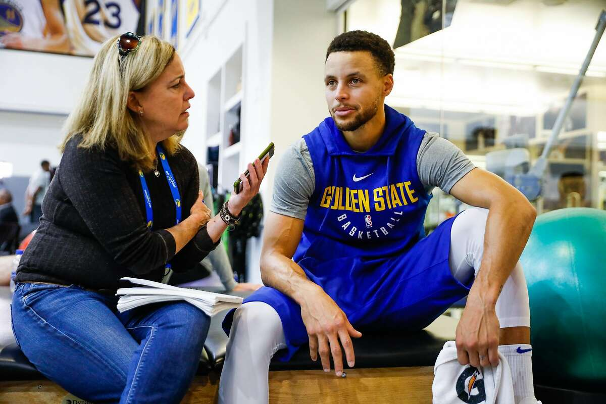 Golden State Warriors Stephen Curry speaks with reporter Ann Killion of the San Francisco Chronicle for an interview at the practice gym in Oakland, California, on Wednesday, Oct. 24, 2018.