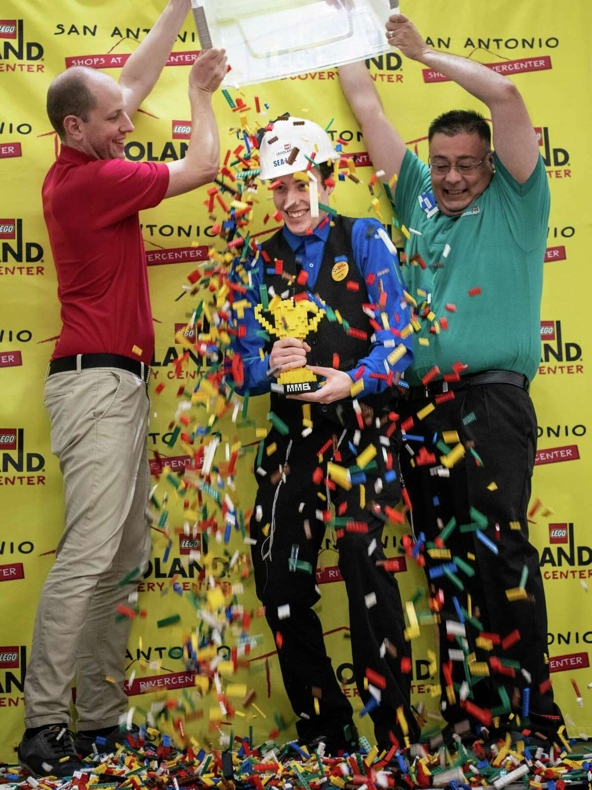 Winner Kevin Hintz is showered with LEGOs during a lego-building competition to name the new Lego Master Builder for LEGOLAND Discovery Center San Antonio opening soon on Sunday, January 13, 2019. The theme for today's competition was,