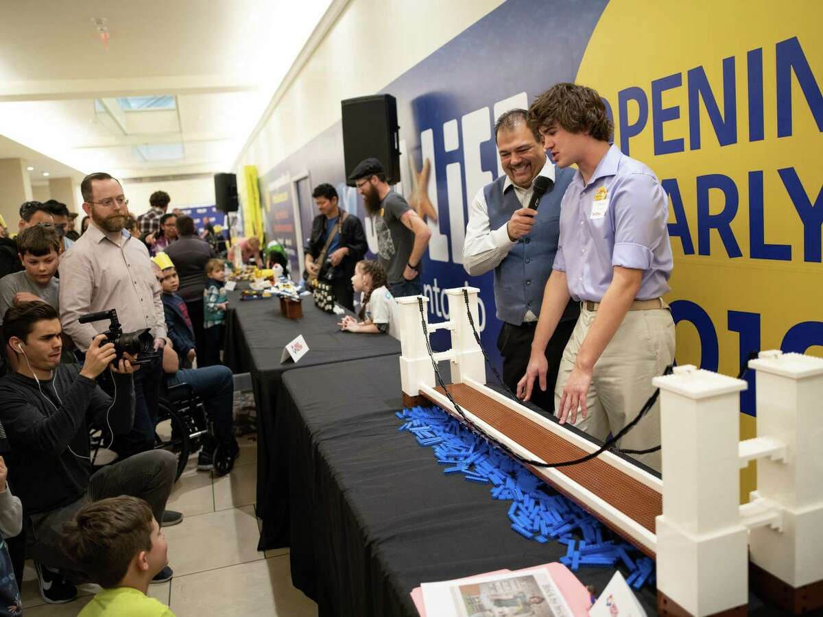 MC Roman Garcia, second right, interviews Finalist Stanton Bain on his suspension bridge creation during a lego-building competition to name the new Lego Master Builder for LEGOLAND Discovery Center San Antonio opening soon on Sunday, January 13, 2019. The theme for today's competition was,