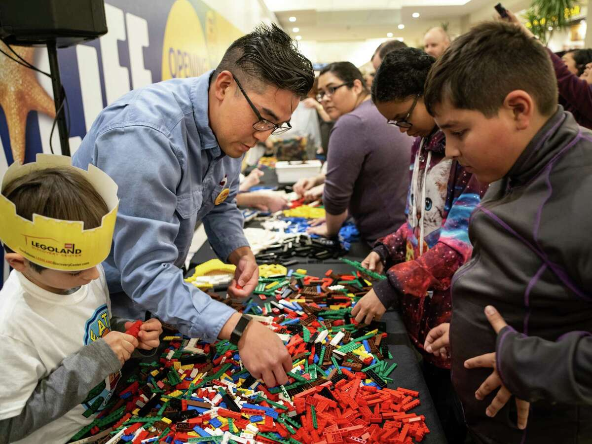 Finalist Bradd Waki, second left, begins to build his construction during a lego-building competition to name the new Lego Master Builder for LEGOLAND Discovery Center San Antonio opening soon on Sunday, January 13, 2019. The theme for today's competition was,