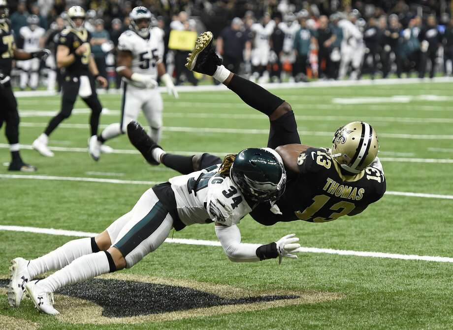 New Orleans Saints wide receiver Michael Thomas (13) pulls in a touchdown reception against Philadelphia Eagles cornerback Cre'von LeBlanc (34) in the second half of an NFL divisional playoff football game in New Orleans, Sunday, Jan. 13, 2019. (AP Photo/Bill Feig) Photo: Bill Feig, Associated Press