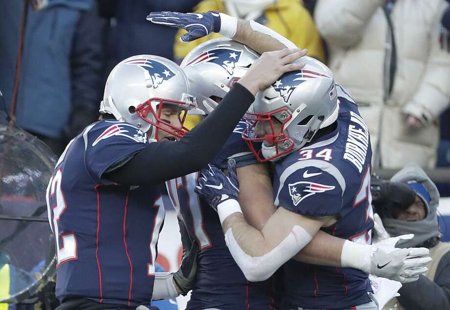 Patriots quarterback Tom Brady congratulates running back Rex Burkhead after Burkhead scored a second-quarter touchdown against the Chargers on Sunday. Photo: Robert Gauthier / TNS / Los Angeles Times